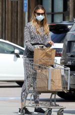 April Love Geary Sports leopard print as she gets another Stock Pile of groceries