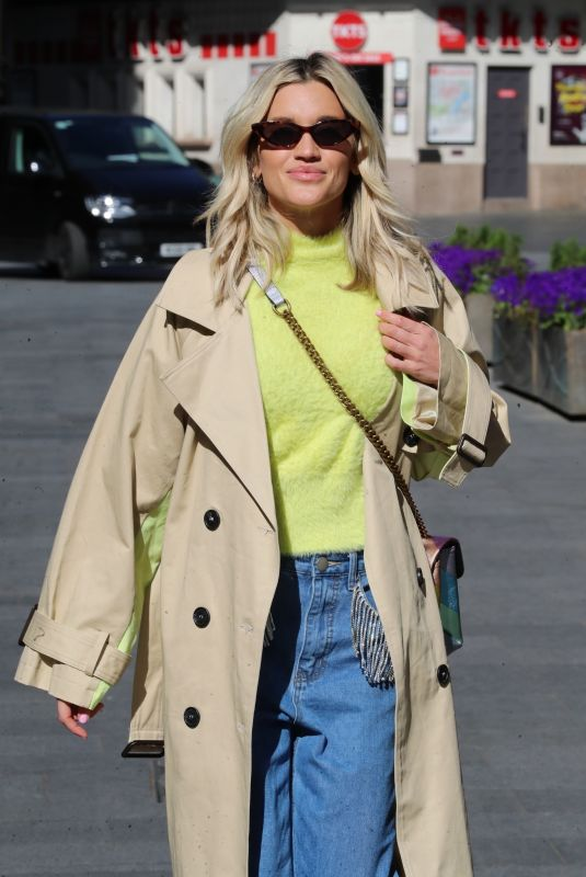 Ashley Roberts Leaving the Heart Radio Studios in denim trousers and fluffy Top in London
