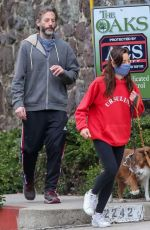 Aubrey Plaza and Jeff Baena wear protective masks while walking their dogs