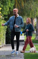 Brittany Snow and husband Tyler Stanaland take a walk around their Los Angeles neighborhood with their dog