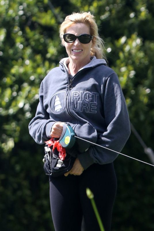 Camille Grammer Enjoys the sunshine while walking her dog