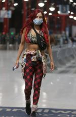 Carla Howe Sports a mask in London