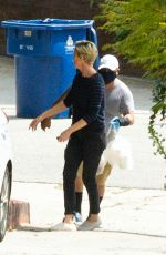 Charlize Theron Receives a delivery outside her home in LA