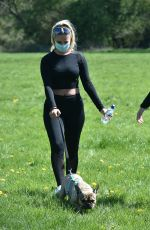 Chloe Ross and her sister Madison Ross wear surgical face masks to walk there dog in Chigwell, Essex