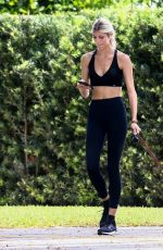 Devon Windsor Walking her dog in Coral Gables