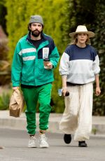 Elizabeth Olsen and husband Robbie Arnett pick up lunch to-go during stay-at-home order