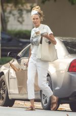 Elle Macpherson Meeting up with friends at a Miami condo