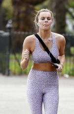 Emily Blackwell and new boyfriend Harvey Armstrong seen out for a run as she struggles to keep up in London
