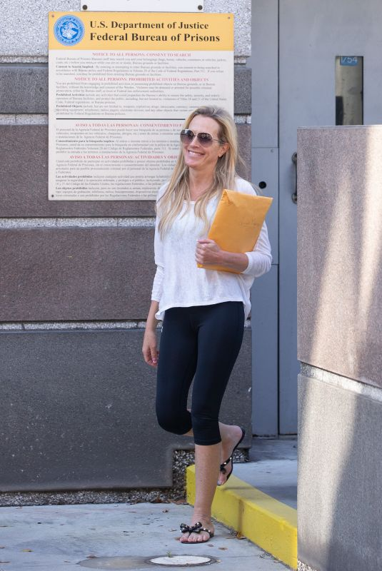 Ex-Miss Florida Karyn Turk was all smiles as she left federal prison in Miami