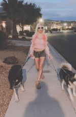Frenchy Morgan Walks her dogs in her private community, unafraid of the Coronavirus