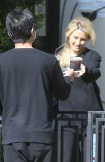 Holly Madison Gets her iced coffee delivered during the quarantine