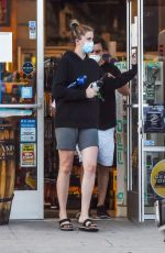 Ireland Baldwin daughter of actors Kim Basinger and Alec Baldwin does a quarantine run with her boyfriend Cory in Los Angeles