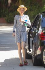Jaime King Arrives at a friend