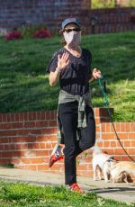 Juliette Lewis Takes her two dogs for a walk with some family members in Los Angeles