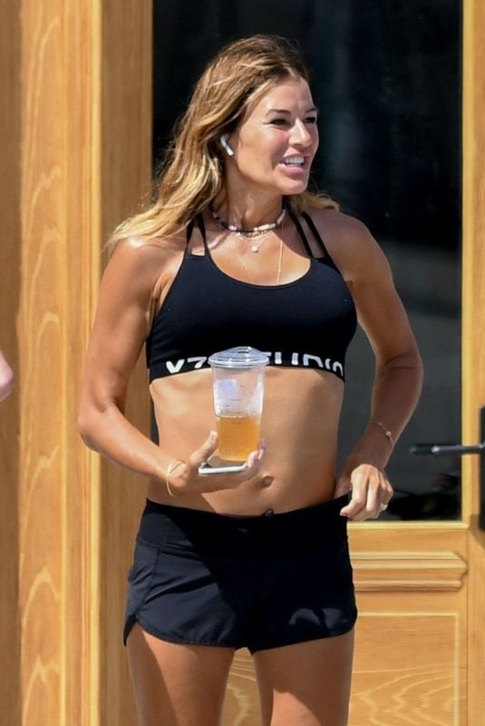 Kelly Bensimon and friends take her dog for a walk while enjoying the sights in Palms Beach