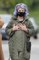 Kelly Osbourne Goes for a walk on a rainy day with Jack Osbourne