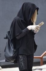 Kimberly Stewart Stops for coffee wearing a face mask
