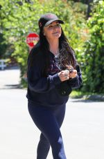 Kyle Richards Goes out for a walk while putting on her face mask