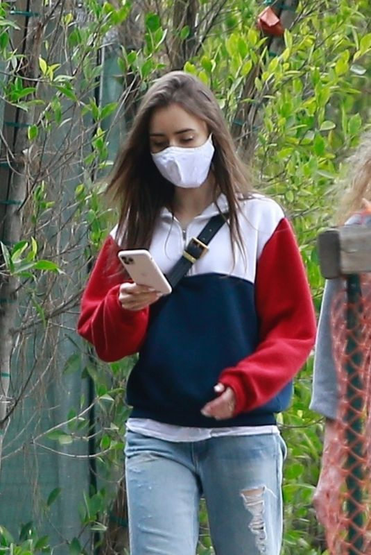 Lily Collins Out for a walk with her mother in Beverly Hills