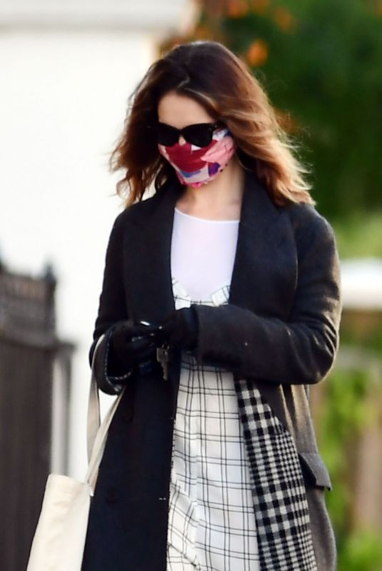 Lily James Wearing a protective face mask during the Coronavirus lockdown as she