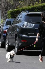 Lucy Hale Breaks from isolation and goes for a walk with her dog Elvis in her Los Angeles