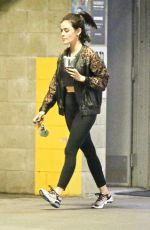 Lucy Hale Takes a sip of her drink as she exits a private training session in Los Angeles