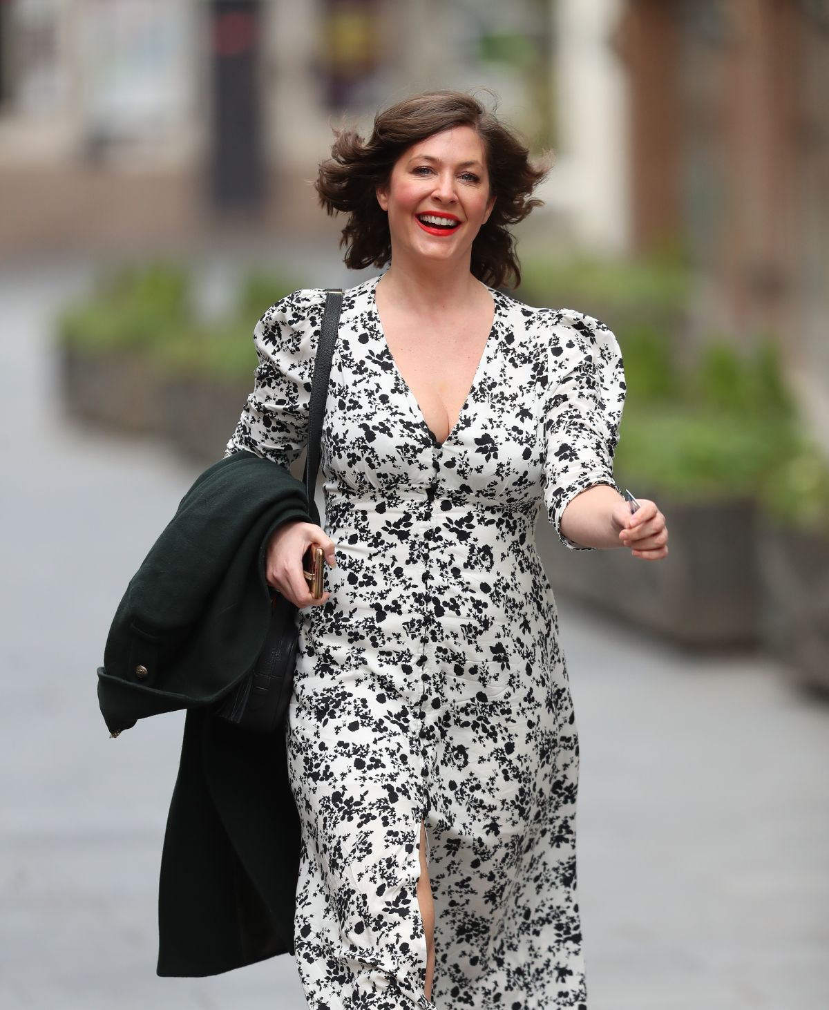 Lucy Horobin Makes Busty Exit In High Split Floral Dress