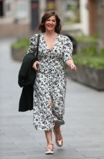 Lucy Horobin Makes busty exit in high split floral dress from Global Offices