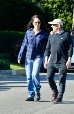 Madeleine Stowe Goes out for an afternoon stroll with actor husband Brian Benben in Pacific Palisades