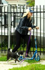 Malin Akerman Rides a scooter to walk her dog