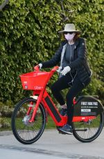 Marcia Cross Goes out for a bike ride with a mask and gloves