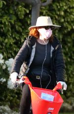 Marcia Cross Goes out for a bike ride with a mask and gloves in Santa Monica