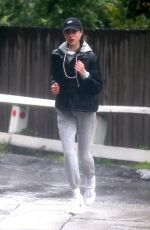 Margaret Qualley Braves the Rain for a Run