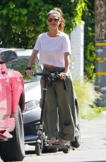 Maria Menounos Riding an electric scooter in Los Angeles