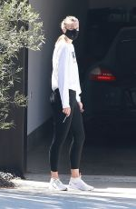 Maria Sharapova Inspects her ride after getting it delivered from the dealer