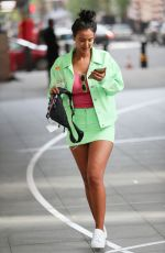 Maya Jama In mint-green matching miniskirt and jacket while leaving BBC Radio One