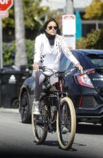 Michelle Rodriguez Rides a bike with a girlfriend during COVID-19 pandemic