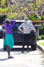 Molly Sims Wearing a bandana as she goes for a stroll around neighborhood