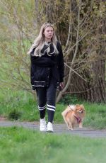 Molly Smith Walks her dog during the Coronavirus lockdown close to her Manchester Home