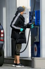 Nicole Murphy Heads to a Starbucks Drive Thru then Stops for Gas in West Hollywood
