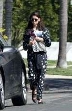 Nina Dobrev Carries her sneakers out in LA