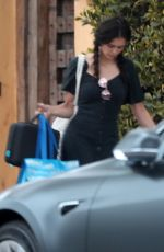 Nina Dobrev Leaves her home with the tag on her dress in West Hollywood