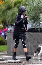 Nina Dobrev Steps out and braves the rain to take her dog Maverick out for a walk near her Los Angeles home
