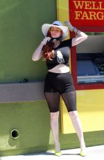 Phoebe Price Braves the heat on Friday for an ATM trip in Los Angeles