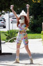 Phoebe Price Hula Hoops into the New Week