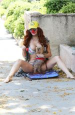 Phoebe Price In a bikini while walking her dog Henry in Los Angeles