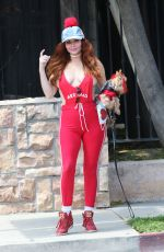 Phoebe Price In red as she walks her dog in Miami