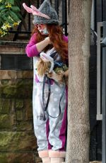 Phoebe Price Seen in Easter Bunny ears walking her dog on a rainy day in LA
