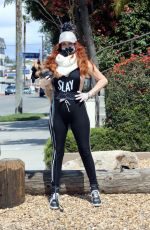 Phoebe Price Shows off a new mask as she walks her dog in LA