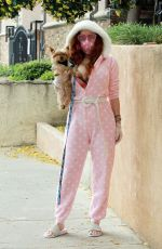 Phoebe Price Wearing her pajamas while taking her dog out for a brief walk